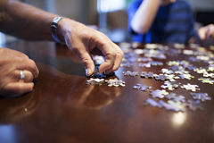 Doing a puzzle Royalty Free Stock Images