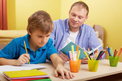 Doing schoolwork at home Royalty Free Stock Photos
