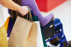 Doing shopping with handicapped Royalty Free Stock Images