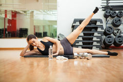 Doing side crunches at the gym stock image