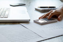 Doing some calculations. Analyzing numbers and doing calculations at the office stock image