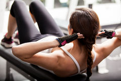 Doing some crunches at the gym royalty free stock image