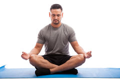 Doing some meditation on a yoga mat Stock Photo