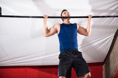 Doing some pull ups Stock Photos