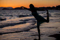 Doing some yoga at sunset Stock Photography