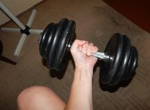 Doing sports, bodybuilding and dumbbell. In hand Stock Photo
