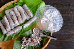 Doing spring rolls. Doing Vietnamese egg roll or spring rolls or cha gio, is popular food at Vietnam cuisine, stuffing from meat and wrapper by rice paper Stock Photo