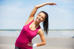 Doing stretching exercises. Stock Photo