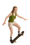 Doing a stunt. Teenager-skateboarder is doing a stunt, isolated on white background Royalty Free Stock Photos