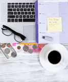 Doing taxes on line with desktop work related objects Royalty Free Stock Images