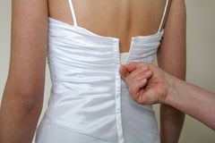 Doing up the brides dress Royalty Free Stock Image
