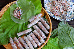 Doing spring rolls. Doing Vietnamese egg roll or spring rolls or cha gio, is popular food at Vietnam cuisine, stuffing from meat and wrapper by rice paper Royalty Free Stock Photo