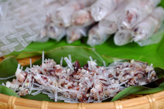 Doing spring rolls. Doing Vietnamese egg roll or spring rolls or cha gio, is popular food at Vietnam cuisine, stuffing from meat and wrapper by rice paper Royalty Free Stock Images