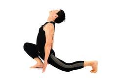 Doing yoga. Man doing yoga on white background Stock Photo