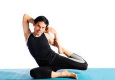 Doing yoga. Man doing yoga on white background Stock Images