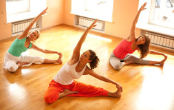Doing yoga in health club Stock Photography