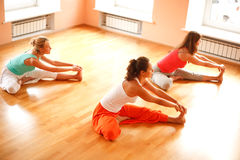 Doing yoga in health club. Three women is doing yoga at health club.High angle view Royalty Free Stock Photos