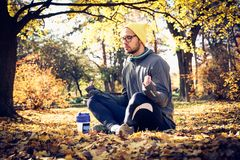 Doing yoga in nature is so spiritual. Man after exercise Stock Image