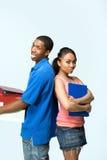 Dois adolescentes estão para trás para suportar - o vertical Fotografia de Stock Royalty Free