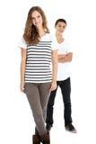 Dois adolescentes novos na moda de sorriso Imagem de Stock