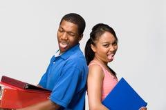 Dois adolescentes que furam horizontal Out- da sua lingüeta Fotos de Stock