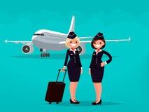 Dois aeromoços contra o contexto de aviões civis Fotografia de Stock Royalty Free