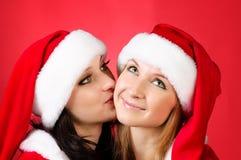 Dois amigos de menina em trajes dos christmass Fotografia de Stock Royalty Free