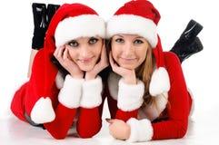 Dois amigos de menina em trajes dos christmass. Foto de Stock Royalty Free