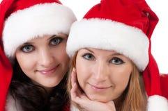 Dois amigos de menina em trajes dos christmass imagens de stock royalty free