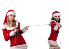 Dois amigos de menina em trajes dos christmass. fotos de stock royalty free