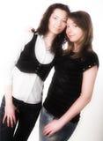 Dois amigos de menina que sorriem junto Imagens de Stock