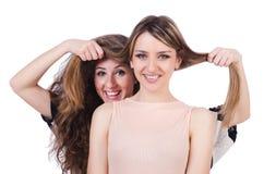 Dois amigos fêmeas isolados Imagem de Stock