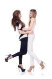 Dois amigos fêmeas isolados Fotos de Stock