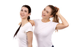 Dois amigos fêmeas no fundo branco Fotografia de Stock Royalty Free