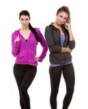 Dois amigos fêmeas no fundo branco Imagens de Stock Royalty Free