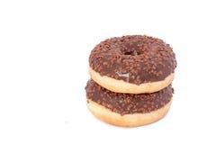 Dois anéis de espuma do chocolate com polvilham Isolado em um fundo branco Fotografia de Stock Royalty Free