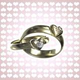 Dois anéis dourados com corações e diamantes Fotos de Stock