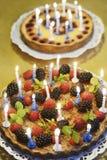 Dois bolos de aniversário com velas Imagem de Stock