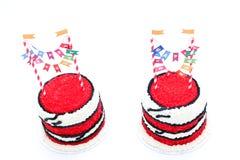 Dois bolos de aniversário vermelhos para gêmeos Fotos de Stock