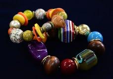 Dois braceletes das pedras no preto Fotografia de Stock Royalty Free