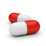 Cápsulas brancas e vermelhas Fotografia de Stock
