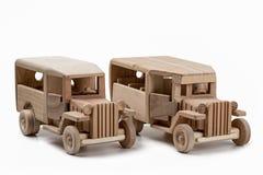 Dois brinquedos de madeira do ônibus do vintage no estúdio Foto de Stock Royalty Free