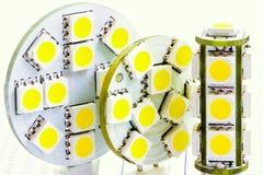 Dois bulbos lisos do diodo emissor de luz e um bulbo cilíndrico G4 do diodo emissor de luz Imagem de Stock