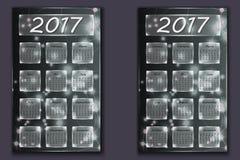 Dois calendários com ano abstrato do fundo do bokeh em 2017 Imagem de Stock