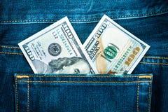 Dois cem dólares no bolso das calças de brim Imagens de Stock Royalty Free