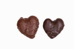 Dois chocolates dados forma coração Fotografia de Stock