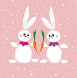 Dois coelhos com cenoura Imagens de Stock Royalty Free