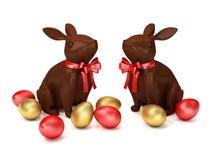 Dois coelhos do chocolate com ovos da páscoa dourados ilustração 3D ilustração stock