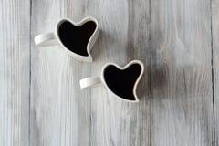 Dois copos de café da forma do coração Fotografia de Stock Royalty Free