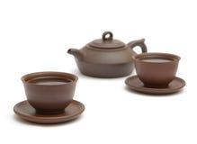Dois copos do chá e do teapot do marrom Foto de Stock